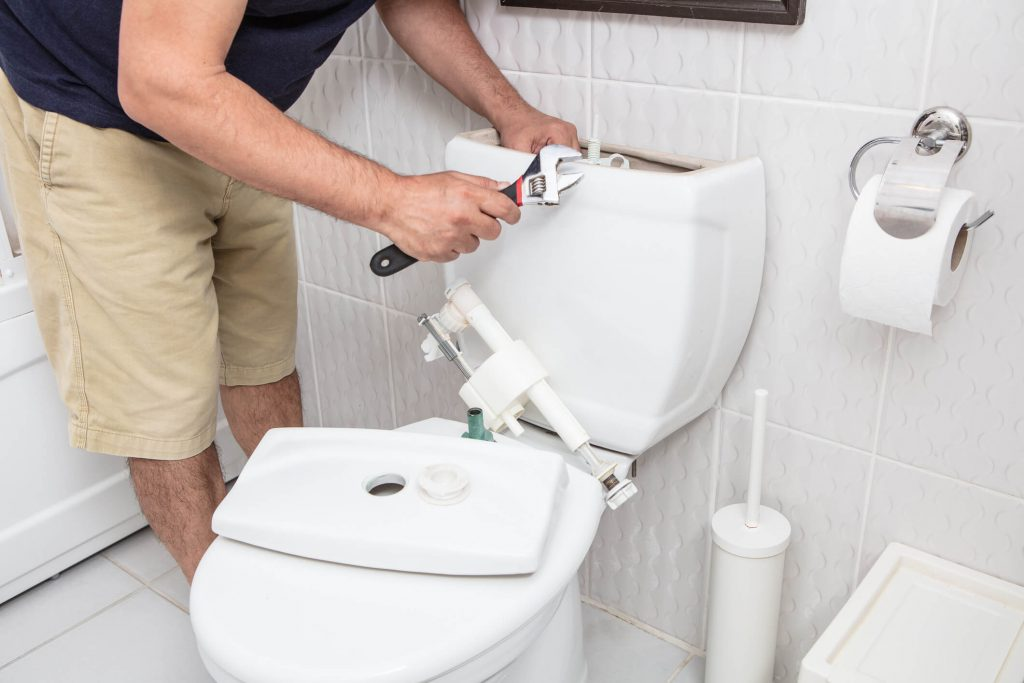 fort worth landlord fixing toilet