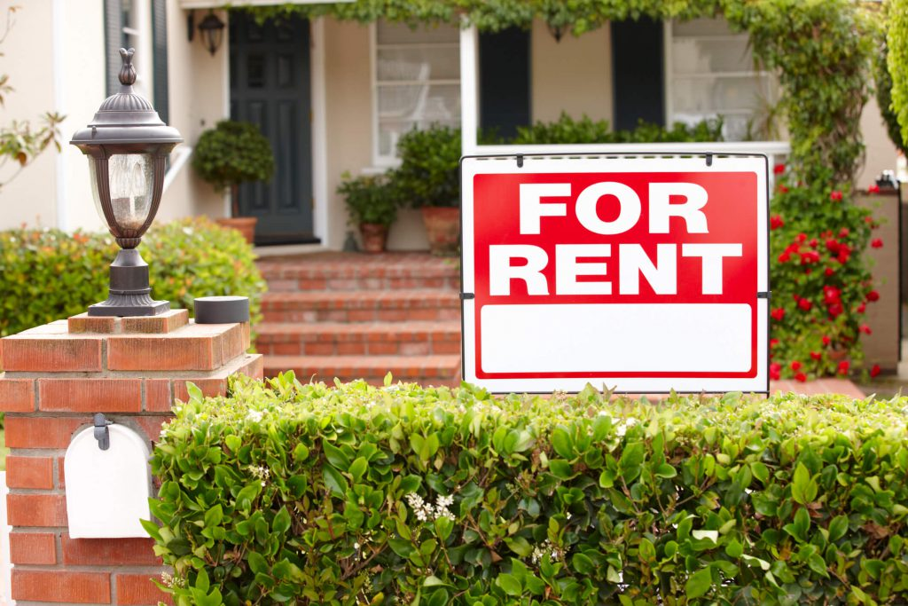 destin rental home with for rent sign in yard
