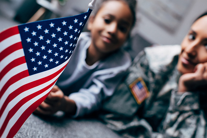 How it works: military family holding flag