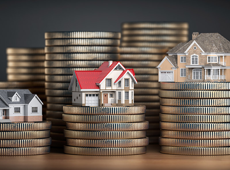 We'll Help You Invest Wisely: miniature houses on top of coins