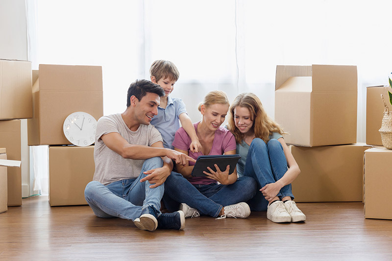 Looking to buy a home?: family looking at ipad